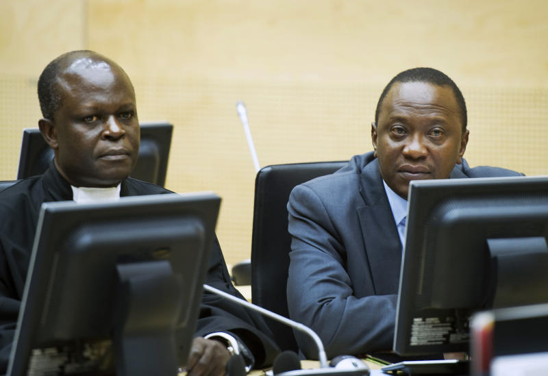 Deputy Prime Minister Uhuru Kenyatta, son of Kenyan independence hero and founding president Jomo Kenyatta, right, sits in the courtroom of the International Criminal Court (ICC) in The Hague, Netherlands, Wednesday, Sept. 21, 2011.  Three Kenyans, including Uhuru Kenyatta are appearing at the ICC to establish if prosecutors have a strong enough case to put them on trial for their alleged roles in post-election violence in 2007-2008, including murder, deportation, persecution, rape and inhumane acts committed against supporters of Raila Odinga, the current prime minister. (AP Photo/Paul Vreeker, Pool)
