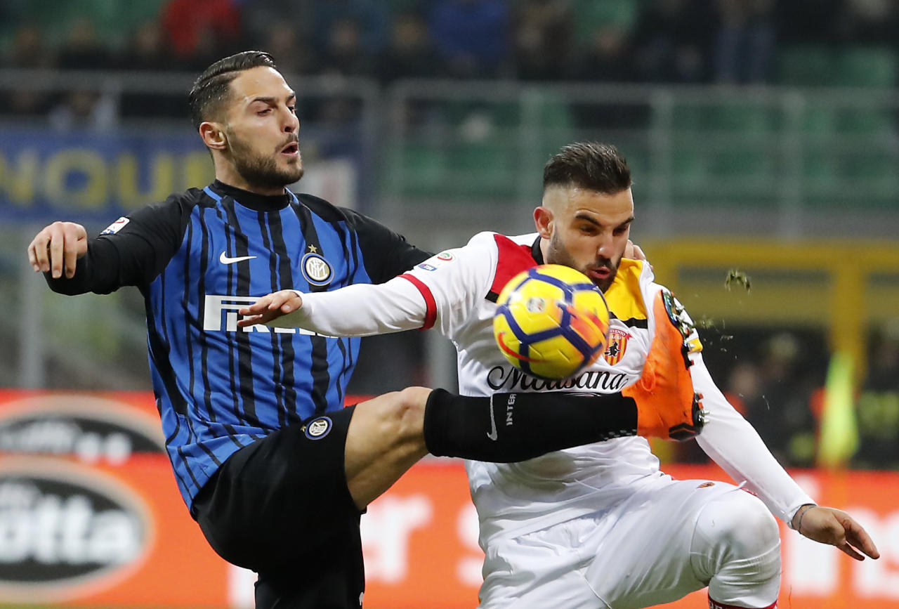 Inter Milan's Danilo D'Ambrosio, left, challenges for the ball with Benevento's Enrico Brignola during the Serie A soccer match between Inter Milan and Benevento at the San Siro stadium in Milan, Italy, Saturday, Feb. 24, 2018. (AP Photo/Antonio Calanni)