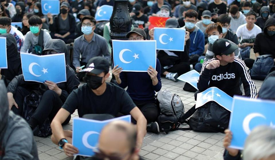 Protesters at a rally in support of Xinjiang Uygurs' human rights in Hong Kong on December 22, 2019. Photo: Reuters