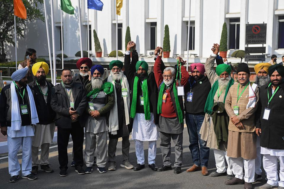 Leaders of protesting farmers pose for media prior to their meeting with India's Agriculture Minister Narendra Singh Tomar in New Delhi on December 30, 2020. (Photo by PRAKASH SINGH/AFP via Getty Images)