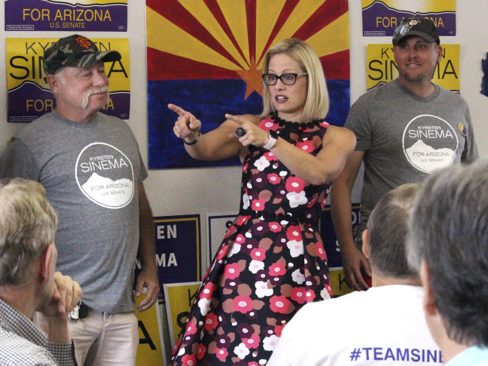 Democrat Kyrsten Sinema talks to volunteers at a get-out-the-vote phone bank in Phoenix, alongside members of Veterans for Sinema, on Nov. 1. (Photo: Bob Christie/AP)