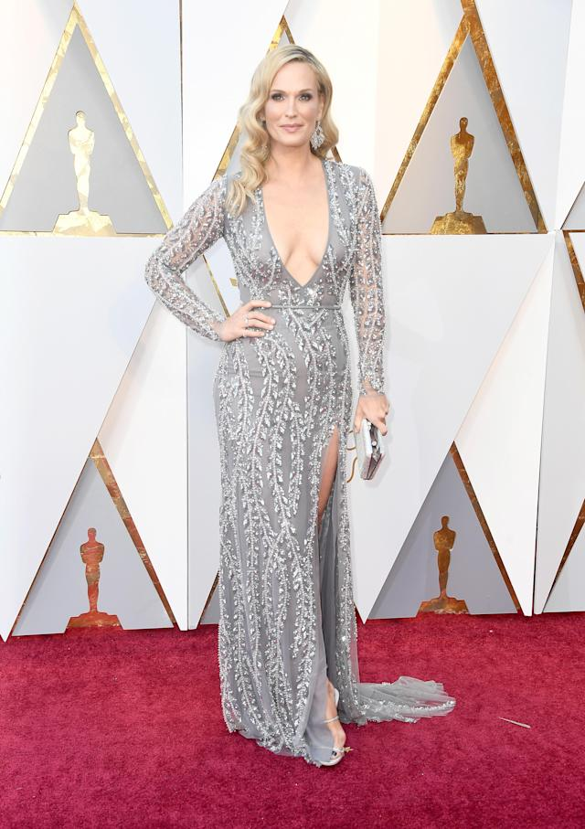 <p>Molly Sims not only wore a sheer dress, but she showed skin thanks to a low neckline and high leg slit too. Sims' shoes are by Rene Caovilla. (Photo: Getty Images) </p>