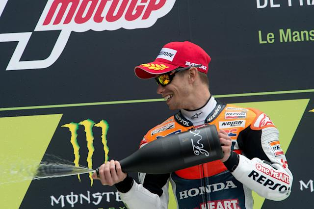 LE MANS, FRANCE - MAY 20: Casey Stoner of Australia and Repsol Honda Team celebrates on the podium and sprays champagne at the end of the French MotoGP race on May 20, 2012 in Le Mans, France. (Photo by Mirco Lazzari gp/Getty Images)