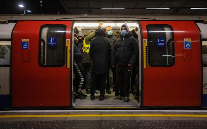 Commuters stand on a Jubilee tube train at Canning Town station in London - Simon Dawson/Bloomberg