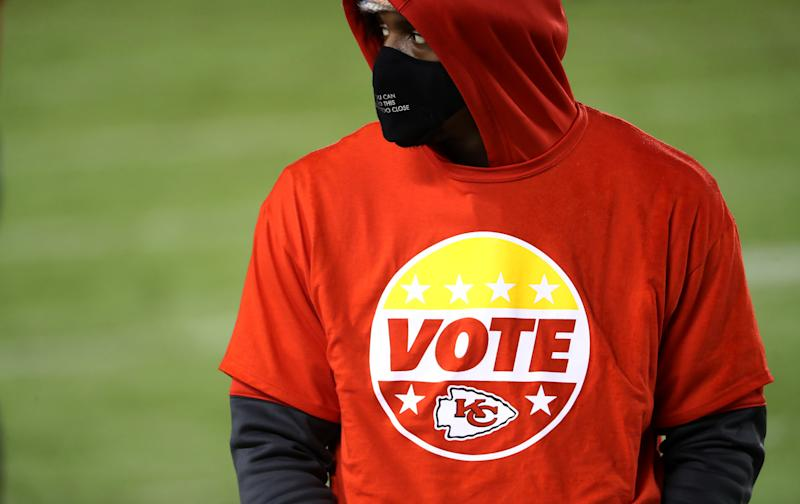 KANSAS CITY, MISSOURI - SEPTEMBER 10: A Kansas City Chiefs player looks on wearing a Vote shirt during the fourth quarter against the Houston Texans at Arrowhead Stadium on September 10, 2020 in Kansas City, Missouri. (Photo by Jamie Squire/Getty Images)