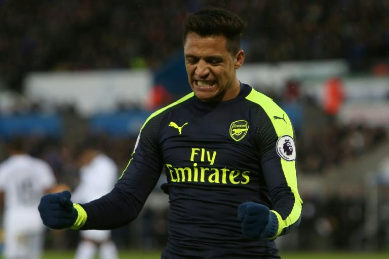 Alexis Sanchez scored the last of Arsenal's four goals against Swansea but appeared far from happy when he was taken off in the final quarter