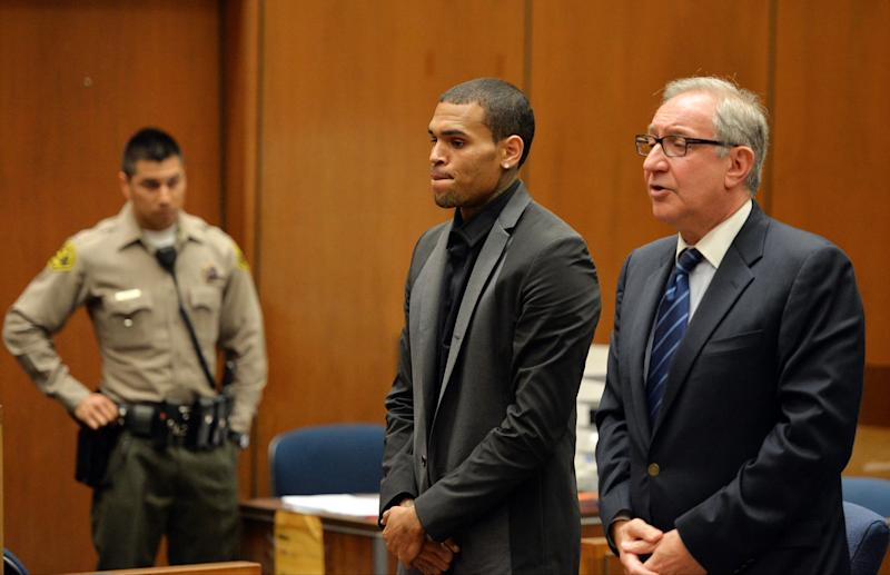 R&B singer Chris Brown, and his Attorney Mark Geragos appear during a court hearing at Los Angeles Superior court in Los Angeles Monday, July 15, 2013. A Los Angeles judge has revoked Chris Brown's probation after reading details of an alleged hit-and-run accident and his behavior afterward, but the singer was not ordered to jail. The prosecutor did not ask for Brown to be jailed. Another hearing is set for Aug. 16. The singer has been on felony probation in the 2009 beating of former girlfriend Rihanna. (AP Photo/Alberto E. Rodriguez, Pool)