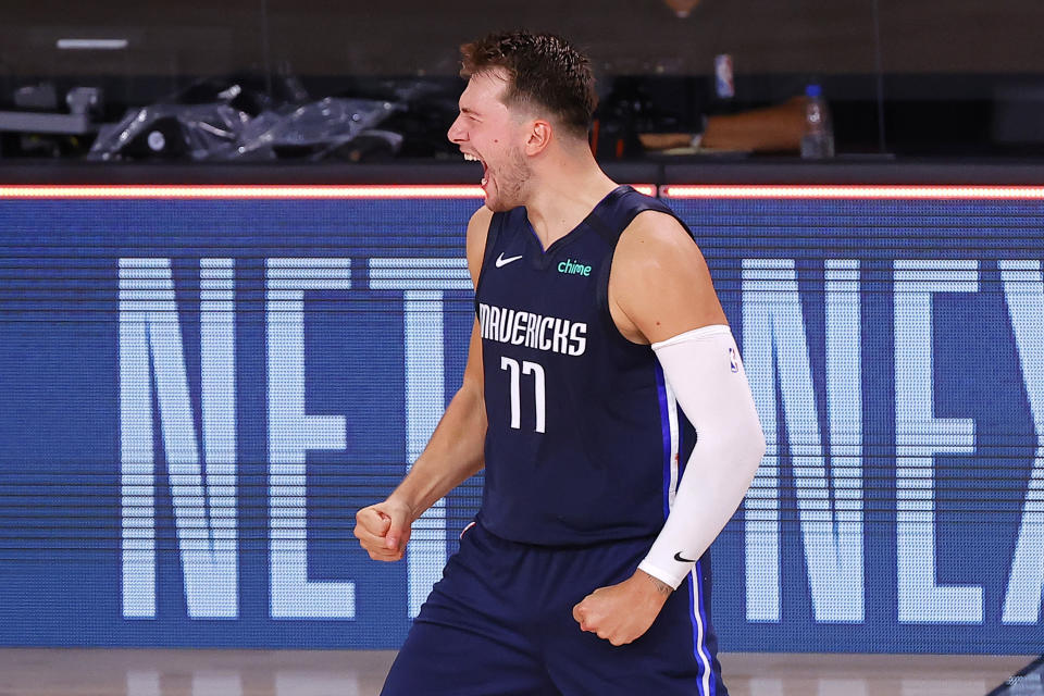 Luka Doncic of the Dallas Mavericks celebrates his game-winning three-point basket against the Los Angeles Clippers during overtime of Game 4 of an NBA basketball first-round playoff series, Sunday, Aug. 23, 2020, in Lake Buena Vista, Fla. (Kevin C. Cox/Pool Photo via AP)