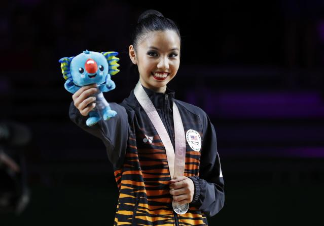 Rhythmic Gymnastics - Gold Coast 2018 Commonwealth Games - Individual Clubs Final - Coomera Indoor Sports Centre - Gold Coast, Australia - April 13, 2018. Koi Sie Yan of Malaysia poses with her silver medal and a plushie of Borobi, the games mascot. REUTERS/David Gray