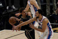 Atlanta Hawks guard Trae Young (11) is defended by Philadelphia 76ers guard Ben Simmons (25) as he looks for an opening during the first half of Game 6 of an NBA basketball Eastern Conference semifinal series Friday, June 18, 2021, in Atlanta. (AP Photo/John Bazemore)