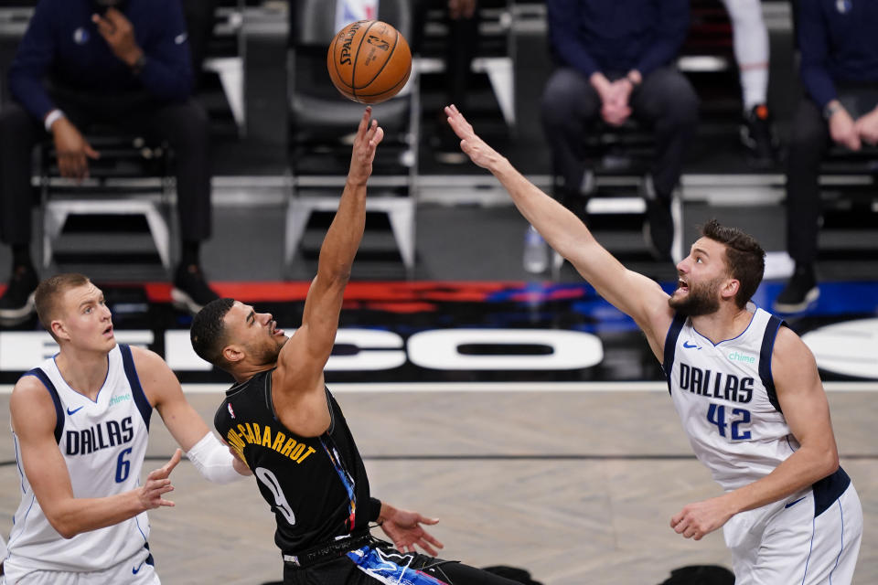 Brooklyn Nets guard Timothe Luwawu-Cabarrot (9) shoots against Dallas Mavericks forward Maxi Kleber (42) during the second half of an NBA basketball game Saturday, Feb. 27, 2021, in New York. (AP Photo/John Minchillo)