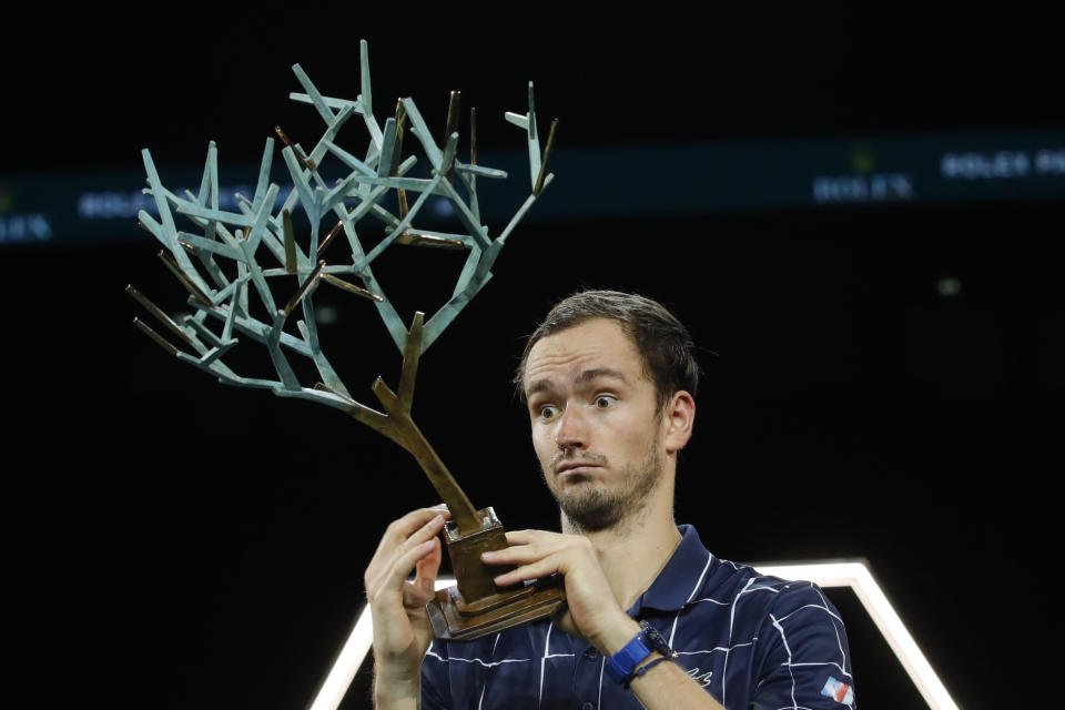 Russia's Daniil Medvedev watches his trophy after the Paris Masters tennis tournament final, Sunday, Nov. 8, 2020 in Paris. Daniil Medvedev won the Paris Masters for the first time by beating Germany's Alexander Zverev 5-7, 6-4, 6-1 on Sunday for his eighth career title and third at a Masters event. (AP Photo/Christophe Ena)