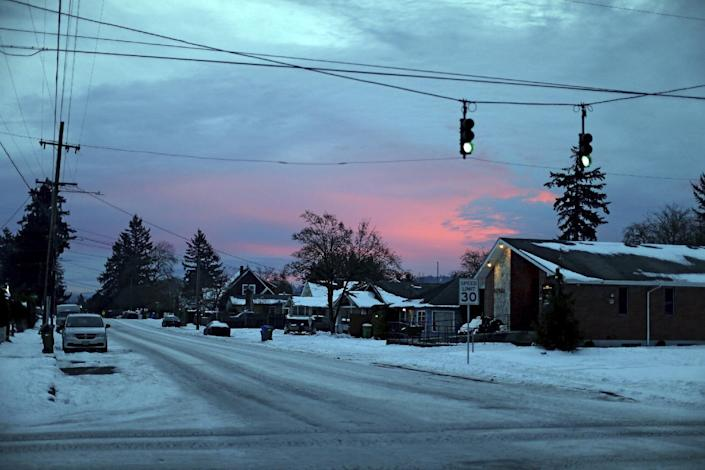 Roads are icy along SE Duke near 72nd Ave., in southeast Portland on Tuesday Jan. 17, 2017. The Portland, Oregon area is bracing for freezing rain that could bring up to an inch of ice to some areas east of the city, with heavier accumulations in the Columbia River Gorge. (Dave Killen/The Oregonian via AP)