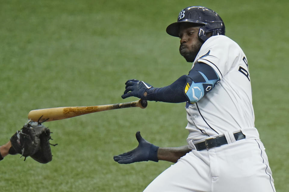 Tampa Bay Rays' Randy Arozarena drops his bat as he ducks away from an inside pitch by New York Yankees' Corey Kluber during the third inning of a baseball game Friday, April 9, 2021, in St. Petersburg, Fla. (AP Photo/Chris O'Meara)