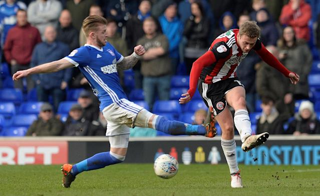 "Soccer Football - Championship - Ipswich Town vs Sheffield United - Portman Road, Ipswich, Britain - March 10, 2018 Sheffield United's James Wilson in action with Ipswich's Luke Hyam Action Images/Alan Walter EDITORIAL USE ONLY. No use with unauthorized audio, video, data, fixture lists, club/league logos or ""live"" services. Online in-match use limited to 75 images, no video emulation. No use in betting, games or single club/league/player publications. Please contact your account representative for further details."