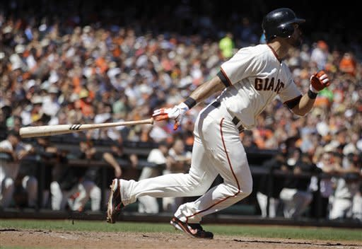 San Francisco Giants' Angel Pagan drops his bat after hitting a two-run triple off Colorado Rockies' Josh Roenicke in the sixth inning of a baseball game on Saturday, Aug. 11, 2012, in San Francisco. (AP Photo/Ben Margot)