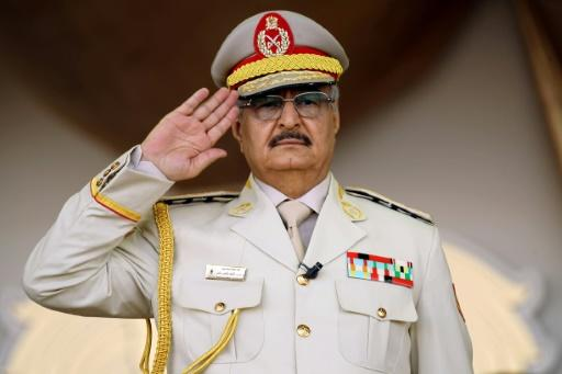 Libyan Strongman Khalifa Haftar salutes during a military parade in the eastern city of Benghazi on May 7, 2018