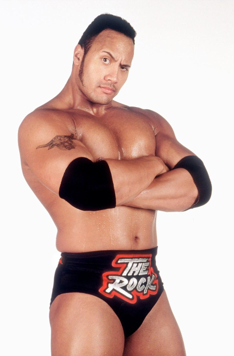 """Dwayne Johnson flexes the People's Eyebrow as his wrestling persona """"The Rock"""" in 1999."""