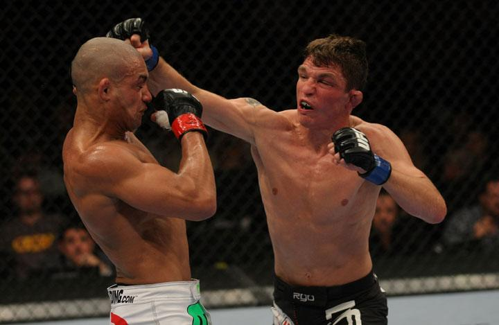 LAS VEGAS, NV - MAY 26:  Darren Elkins (R) punches Diego Brandao during a featherweight bout at UFC 146 at MGM Grand Garden Arena on May 26, 2012 in Las Vegas, Nevada.