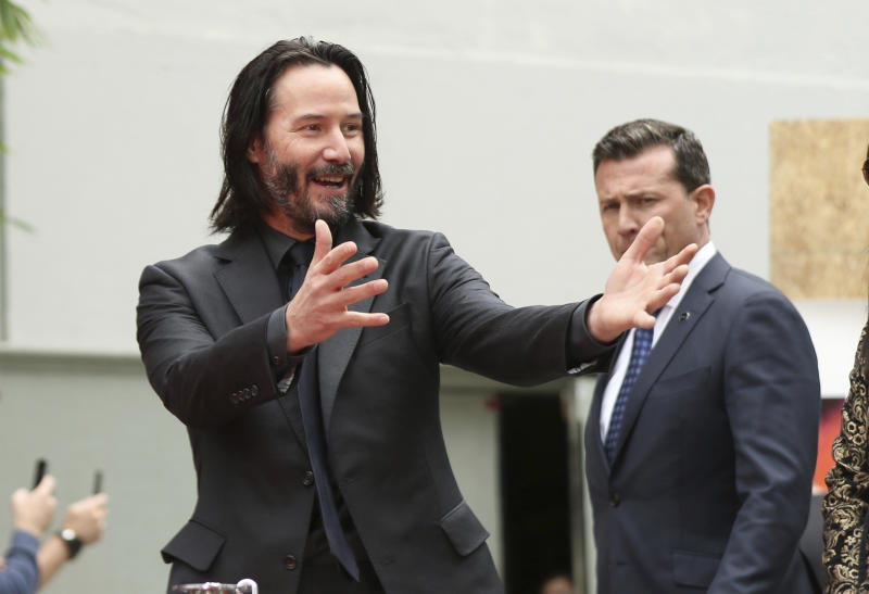 Keanu Reeves arrives at a hand and footprint ceremony honoring him at the TCL Chinese Theatre on Tuesday, May 14, 2019 at in Los Angeles. (Photo by Willy Sanjuan/Invision/AP)