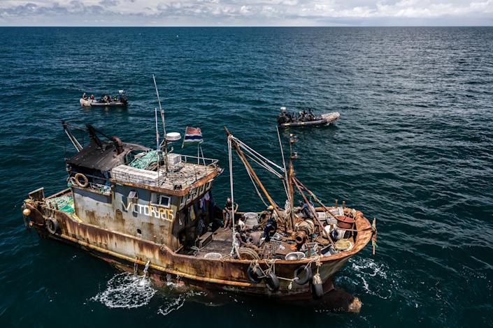 A mix of Senegalese and Gambian workers targeting bonga fish to make into fishmeal and living in squalid conditions working on a Chinese fishing boat. (Fábio Nascimento / The Outlaw Ocean Project)