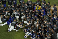 Los Angeles Dodgers manager Dave Robert and third baseman Justin Turner pose for a group picture after defeating the Tampa Bay Rays 3-1 to win the baseball World Series in Game 6 Tuesday, Oct. 27, 2020, in Arlington, Texas. (AP Photo/David J. Phillip)