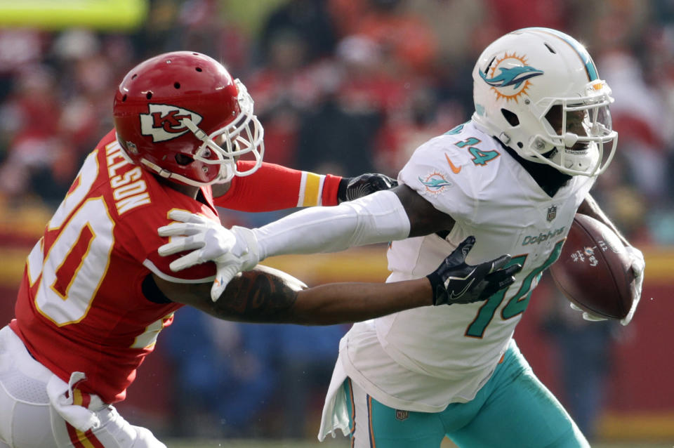 FILE - In this Dec. 24, 2017, file photo, Miami Dolphins wide receiver Jarvis Landry (14) runs away from Kansas City Chiefs defensive back Steven Nelson (20) during the first half of an NFL football game in Kansas City, Mo. A person familiar with the deal says the Dolphins have agreed to trade Landry to the Cleveland Browns for two draft picks. The person confirmed the trade to The Associated Press on condition of anonymity Friday, March 9, 2018, because under NFL rules, no trades can be completed until Wednesday, the start of the leagues new year. (AP Photo/Charlie Riedel, File)