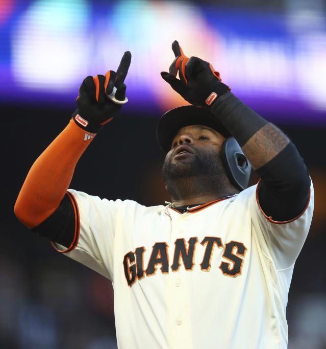 San Francisco Giants' Pablo Sandoval celebrates after hitting a two-run home run off Miami Marlins pitcher Caleb Smith in the second inning of a baseball game Monday, June 18, 2018, in San Francisco. (AP Photo/Ben Margot)