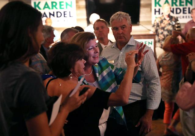 <p>Republican candidate Karen Handel takes a selfie with a supporter during a campaign stop at Houck's Grille as she runs for Georgia's 6th Congressional District on June 19, 2017 in Roswell, Ga. (Photo: Joe Raedle/Getty Images) </p>