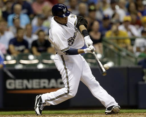 Milwaukee Brewers' Carlos Gomez hits a home run during the fifth inning of a baseball game against the Miami Marlins, Friday, July 19, 2013, in Milwaukee. (AP Photo/Morry Gash)