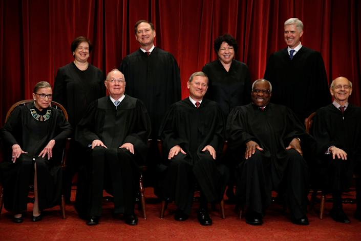 U.S. Supreme Court Justice Anthony Kennedy (bottom 2nd L) reacts while chatting with Chief Justice John Roberts (C) during a new U.S. Supreme Court family photo including Justice Neil Gorsuch (top R), their most recent addition, at the Supreme Court building in Washington, D.C., U.S., June 1, 2017. Also pictured are Justice Ruth Bader Ginsburg (front row, L-R), Justice Clarence Thomas, Justice Stephen Breyer, Justice Elena Kagan (back row, L-R), Justice Samuel Alito and Justice Sonia Sotomayor.