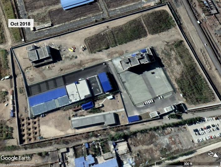 Satellite imagery of a suspected detention site in October 2018 shows internal walls and extensive wire fencing.