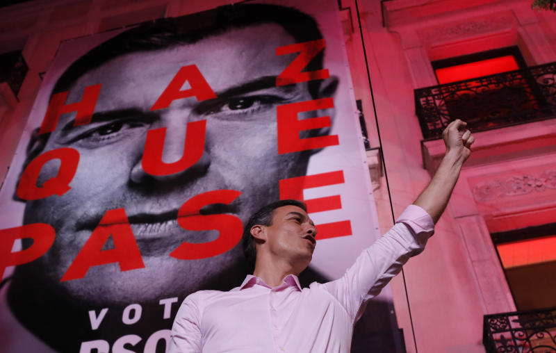 Spain's Prime Minister and Socialist Party leader Pedro Sanchez gestures to supporters outside the party headquarters following the general election in Madrid, Spain, Sunday, April 28, 2019. A divided Spain voted Sunday in its third general election in four years, with all eyes on whether a far-right party will enter Parliament for the first time in decades and potentially help unseat the Socialist government. (AP Photo/Bernat Armangue)