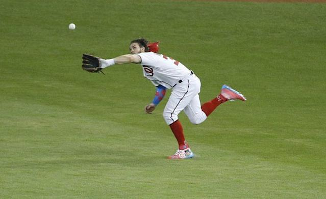 Bryce Harper made an outstanding catch, and then executed an outstanding hair flip. (AP Photo)