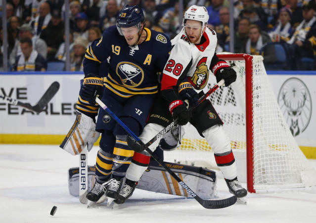 Buffalo Sabres defenseman Jake McCabe (19) and Ottawa Senators forward Connor Brown (28) work for position during the second period of an NHL hockey game Saturday, Nov. 16, 2019, in Buffalo, N.Y. (AP Photo/Jeffrey T. Barnes)