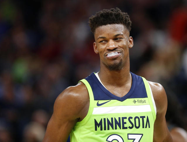 "<a class=""link rapid-noclick-resp"" href=""/nba/players/4912/"" data-ylk=""slk:Jimmy Butler"">Jimmy Butler</a> let his friend down with this trust fall. (AP Photo)"