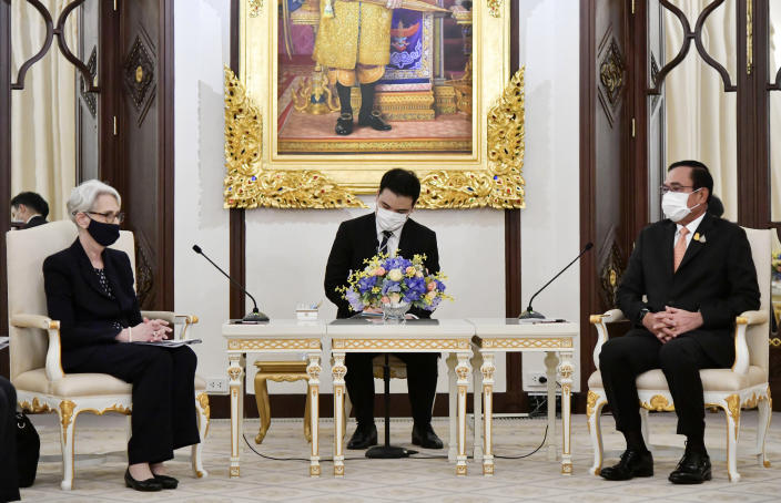 In this photo released by Government Spokesman Office, U.S. Deputy Secretary of State Wendy R. Sherman, left, meets Thailand's Prime Minister Prayuth Chan-ocha, right, at Government House in Bangkok, Thailand, Wednesday, June 2, 2021. (Government Spokesman Office via AP)