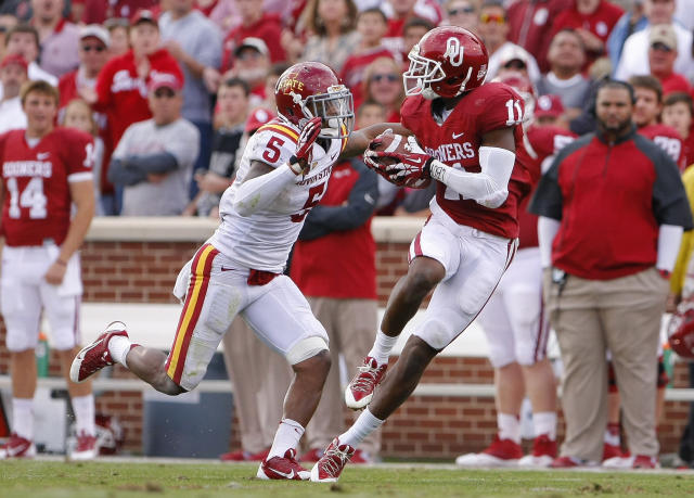 Oklahoma Lacoltan Bester (11) carries against Iowa State before being tackled by Jacques Washington (5) in the third quarter of an NCAA college football game in Norman, Okla. on Saturday, Nov. 16, 2013. Oklahoma won 48-10. (AP Photo/Alonzo Adams)