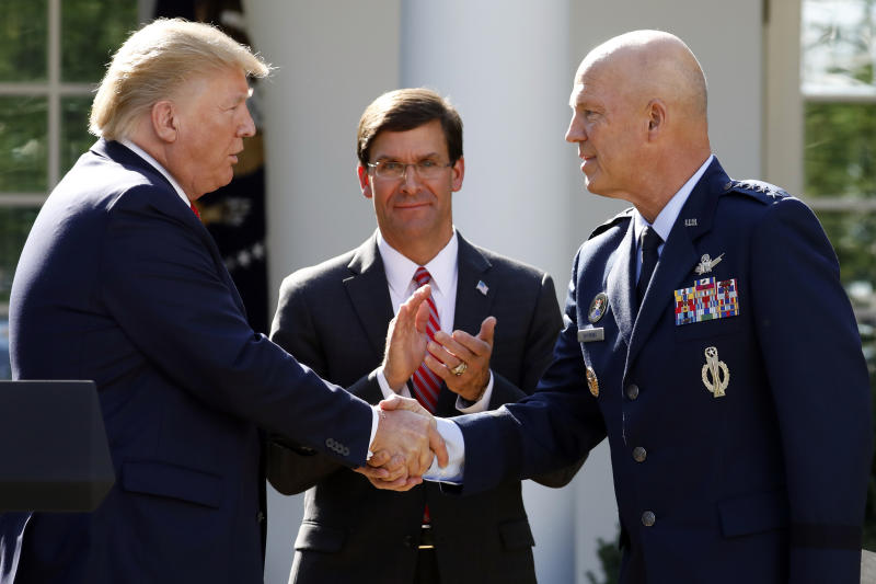 President Donald Trump shakes hands with Gen. Jay Raymond, commander of Air Force Space Command, as Defense Secretary Mark Esper applauds as Trump announces the establishment of the U.S. Space Command in the Rose Garden of the White House in Washington, Thursday, Aug. 29, 2019. (AP Photo/Carolyn Kaster)
