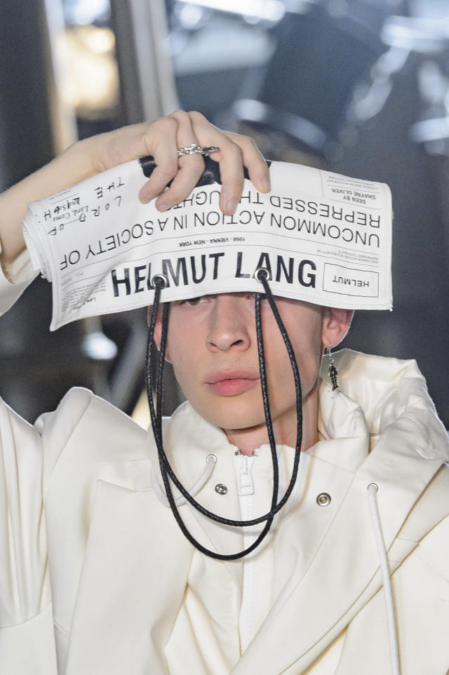 <p><i>Newspaper clutch from the SS18 Helmut Lang collection. (Photo: ImaxTree) </i></p>