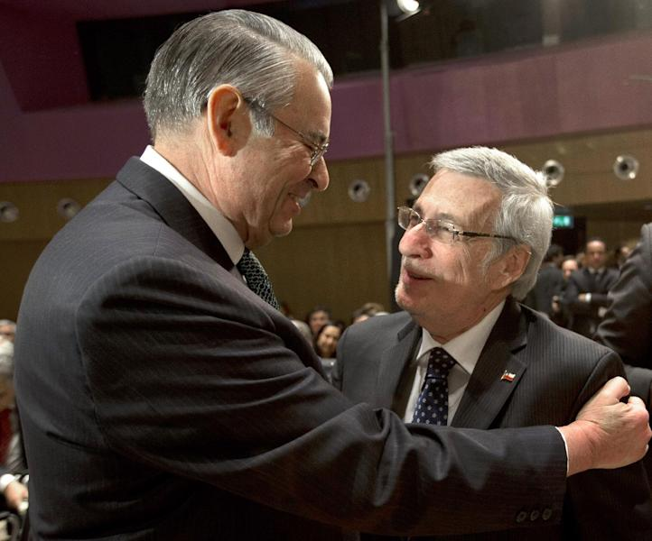 Peru's agent and ambassador Allen Wagner, left, greets Chile's agent and ambassador Albert van Klaveren Stork, right, prior to the start of hearings in a dispute between Peru and Chile over the two countries' maritime boundary at the International Court of Justice in The Hague, Monday Dec. 3, 2012. (AP Photo/Peter Dejong)