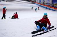People attend indoor ski park at Qiaobo Ice and Snow World in Shaoxing