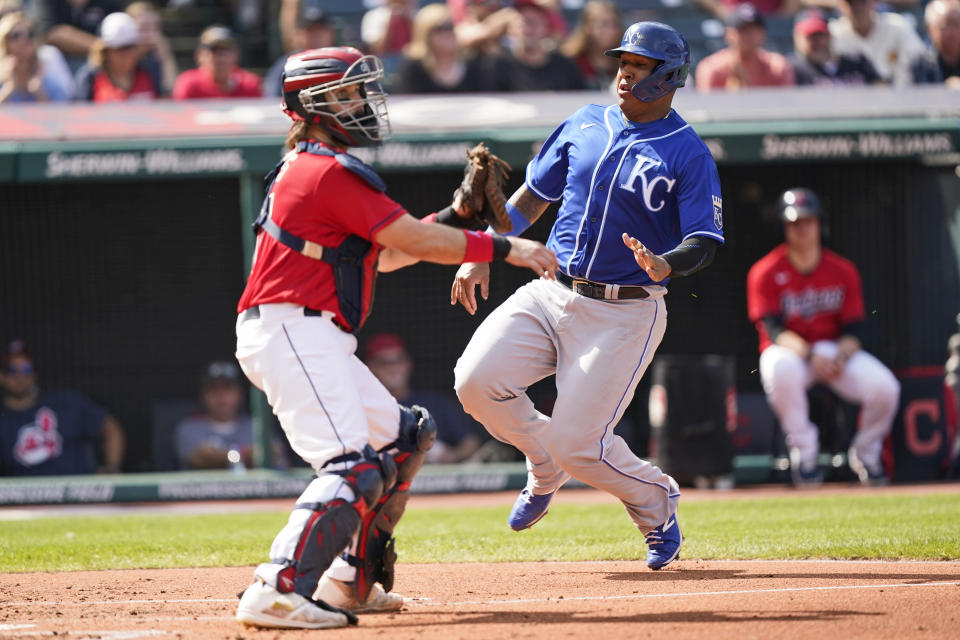 Kansas City Royals' Salvador Perez, right, scores as Cleveland Indians catcher Austin Hedges waits for the ball in the third inning of a baseball game, Monday, Sept. 27, 2021, in Cleveland. (AP Photo/Tony Dejak)