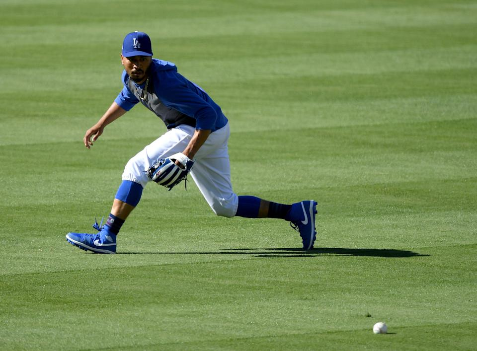 LOS ANGELES, CALIFORNIA - JULY 03:  Mookie Betts #50 of the Los Angeles Dodgers fields at a summer workout in preparation for a shortened MLB season during the coronavirus (COVID-19) pandemic at Dodger Stadium on July 03, 2020 in Los Angeles, California. (Photo by Harry How/Getty Images)
