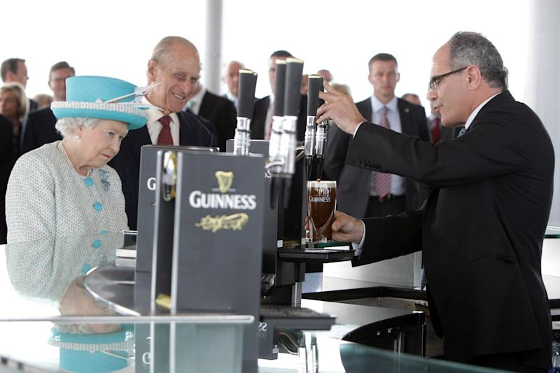 DUBLIN, IRELAND - MAY 18: Queen Elizabeth II and Prince Philip, Duke of Edinburgh visit the Guinness Storehouse and watch the pouring of a pint on May 18, 2011 in Dublin, Ireland. The Duke and Queen's visit to Ireland is the first by a monarch since 1911. An unprecedented security operation is taking place with much of the centre of Dublin turning into a car free zone. Republican dissident groups have made it clear they are intent on disrupting proceedings. (Photo by Irish Government - Pool/Getty Images)