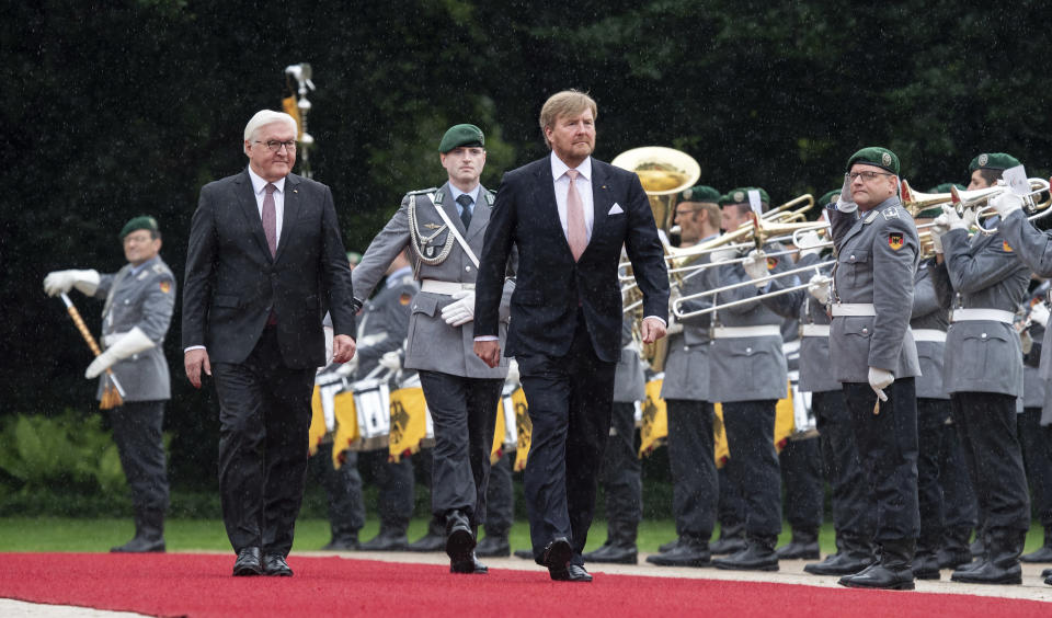 German president Frank-Walter Steinmeier, left, welcomes King Willem-Alexander of the Netherlands with military honours at the Bellevue palace in Berlin, Germany, Monday, July 5, 2021. The Royals arrived in Germany for a three-day visit that was delayed from last year because of the coronavirus pandemic. (Bernd Von Jutrczenka/dpa via AP)