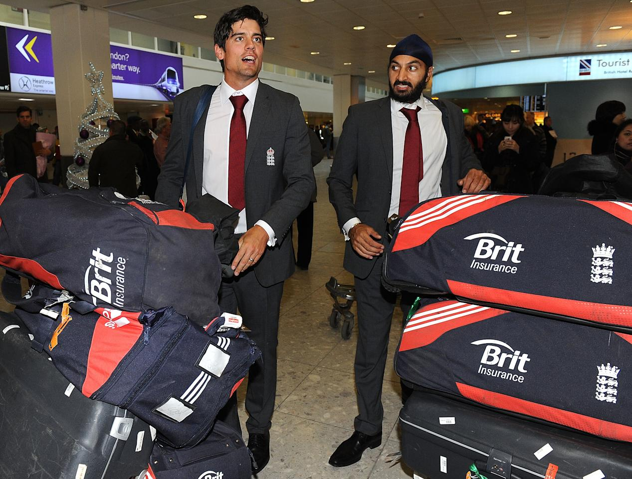LONDON, ENGLAND - DECEMBER 18: England Cricket Team Captain Alastair Cook (L) and Monty Panesar (R) arrive at Heathrow Airport on December 18, 2012 in London, England. (Photo by Tom Dulat/Getty Images)