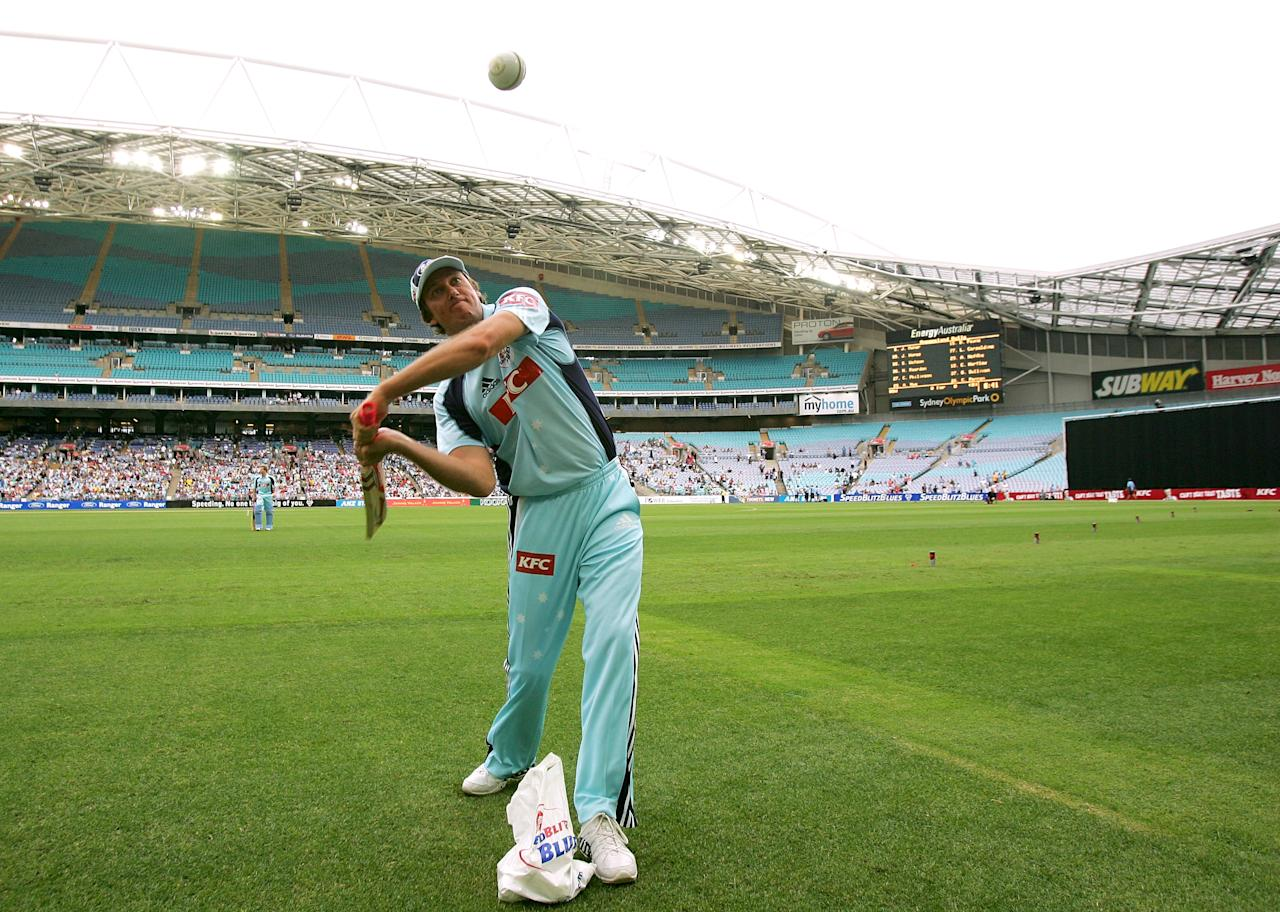 SYDNEY, AUSTRALIA - JANUARY 08:  Glenn McGrath of the Blues hits balls in to the crowd before the KFC Twenty20 Big Bash match between the New South Wales Blues and the Queensland Bulls at ANZ Stadium on January 8, 2008 in Sydney, Australia.  (Photo by Ezra Shaw/Getty Images)