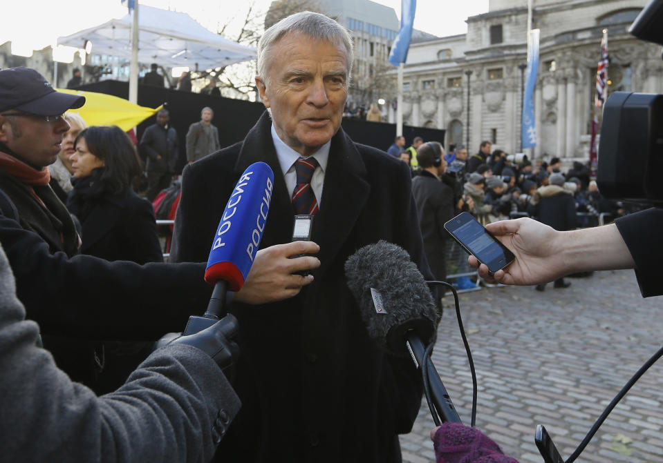 FILE - In this file photo dated Thursday, Nov. 29, 2012, Max Mosley, ex-Formula One boss speaks to the media outside the Queen Elizabeth II Conference Center in London, where Lord Justice Brian Leveson released his report into the culture and practices of the British press and his recommendations for future regulation to prevent phone hacking, data theft, bribery and other abuses. Former Formula One boss and privacy campaigner Max Mosley has died on Sunday May 23, aged 81, it is announced Monday May 24, 2021.(AP Photo/Kirsty Wigglesworth, FILE)