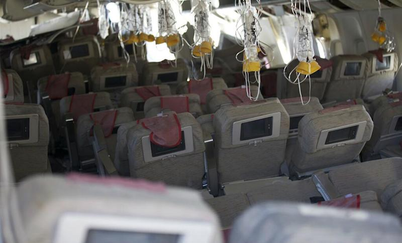 This image released by the National Transportation Safety Board, Sunday, July 7, 2013, shows the interior of the Boeing 777 Asiana Airlines Flight 214 aircraft. The Asiana flight crashed upon landing Saturday, July 6, at San Francisco International Airport, and two of the 307 passengers aboard were killed. (AP Photo/NTSB)